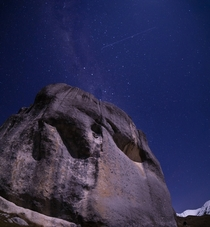 A big meteor strikes the sky over the limestone tors of Kura Tawhiti Canterbury New Zealand