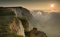 A blanket of thick fog descends on Beachy Head in East Sussex by Adam Barnes