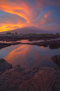 A blazing sunrise and Mauna Loa Hawaiis Big Island during the Lower Puna eruption June of