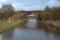 A boating canal with an arched bridge in Wakefield