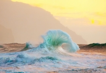 A breaking wave aglow in Kauai Hawaii Lace Andersen