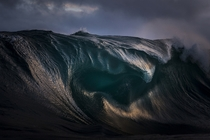 A breaking wave in New South Wales Australia by Ray Collins