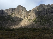 A brief break in the clouds over Dolerite rock formations Walls of Jerusalem National Park Tasmania Australia
