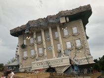 A building in South Myrtle Beach SC designed to look like it fell on its head from the sky