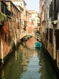 A building-lined canal in Venice Italy  x-post ritookapicture