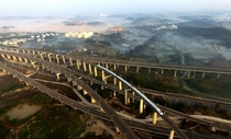 A bullet train on the Tunli grand bridge in Nanning Source Teahsrn