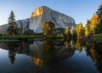 A calm golden sunset on Californias favorite cliff - Yosemite