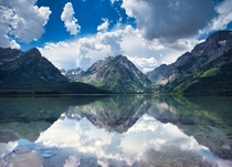 A calm Leigh Lake with Mt Woodring looming at Grand Teton National Park
