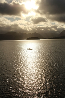A canoeist in the sunlight at Derwent Water The Lake District