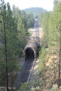 A cave in has been cleared leaving the stand-alone portal and a gap to the rest of the rail road tunnel Applegate California USA
