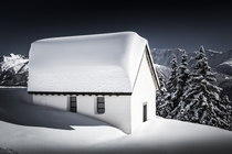 A chapel in the Swiss mountains  Photographed by Frederic Huber