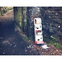 a childrens toy ball machine strangely abandoned by an old railway bridge in the woods still full of stuffed balls giggedy Those things are damn heavy usually seen in supermarkets to distract bored children its sighting in the woods is a mystery Balls fou