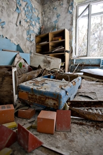 A childs pedal toy car hastily left in one of the kindergarten rooms Pripyat Ukraine