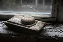 A childs toy tank left on a window ledge in an elementary school Untouched for decades now Chernobyl Ukraine