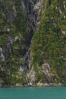 A cleft in the rock craved by waterfall - at Tracy Arm fjord Alaska
