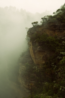 A cliff looming through the mists of Wentworth Falls Australia