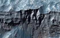 A close-up view of Mars Valles Marineris the largest canyon in the solar system taken by the Mars Reconnaissance Orbiter
