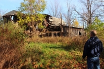 A collapsed barn in small town Michigan Feat My Dad