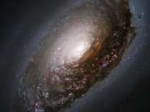 A collision of two galaxies Messier  M has a spectacular dark band of absorbing dust in front of the galaxys bright nucleus giving rise to its nicknames of the Black Eye or Evil Eye galaxy NASAESA and The Hubble Heritage Team