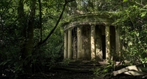 A colonnade in the grounds of the abandoned Baron Hill mansion in Anglesey Wales