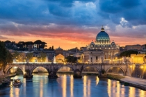 A colorful sunset over Vatican City and the St Peters Basilica in Rome  by Elia Locardi
