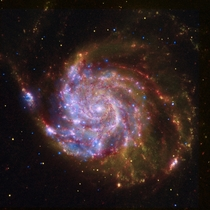 A composite view of the spiral galaxy Messier  from Spitzer Hubble and Chandra