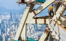 A construction worker atop Shenzhen Chinas new tallest building