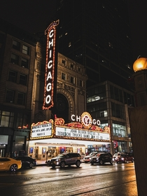 A dark and gloomy night lit up only by the bright lights of Chicagos most iconic theatre