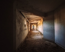A decaying hallway inside of the abandoned Baker Hotel - Mineral Wells TX