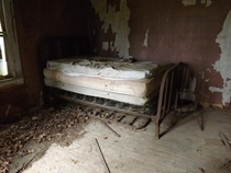 A dingy bed left behind in an abandoned house in Gudger Tennessee The landowner told us the home was used as a living quarters for farmhands working on his fathers farm