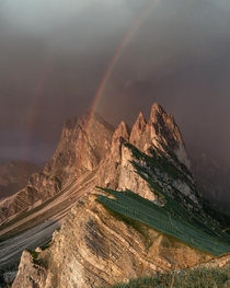 A double rainbow appearing as a storm rolled in over the Dolomites