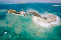 A dredging ship which is creating the Palm Islands Dubai