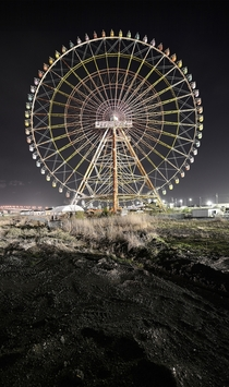 A ferris wheel in an abandoned theme park in Japan  By Reginald Van de Velde
