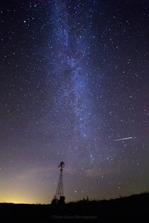 A few stars a meteor and a windmill Near Otoe Nebraska