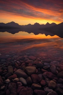 A fiery sunrise over Lake McDonald in Glacier National Park MT I cant wait to backpack in the park next summer  mattymeis