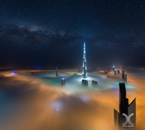A fog bank catching the lights from Dubais streets  by Daniel Cheong
