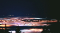 A fog-shrouded Vancouver at night x