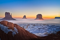 A foggy sunrise on Monument Valley Utah  photo by Dominique Palombieri