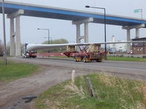 A  foot long wind turbine blade being transported in Duluth MN after having been unloaded from a ship