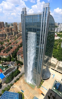 A -foot waterfall cascades down the side of the Liebian Building in Guiyang City China