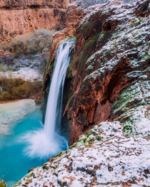 A fresh layer of snow covers the ground surrounding Havasu Falls in Havasupai Indian Reservation AZ  x IG austinsills