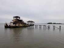A friend of mine took this photo of a well weathered tug boat in Madisonville Louisiana We used to jump off the top when I was younger and dumber