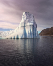 A Frozen Guard Lonely Iceberg in the Morning South Greenland