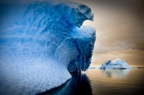 A frozen iceberg wave in the Antarctic Peninsula by Tim McCullough