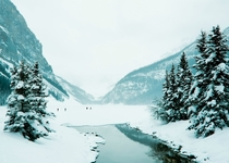 A frozen Lake Louise on a foggy winters day
