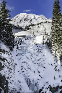 A frozen waterfall and Mt Rainier