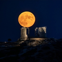 A full Moon rose behind the ancient temple of Poseidon which dates to  BC on Cape Sounion in Greece Credit Muhammed Muheisen