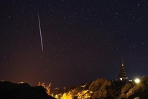A Geminid meteor shower streaking across the night sky in Chiang Mai province northern Thailand  Photo by Rungroj Yongrit