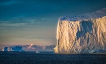 A giant iceberg greeting the sun on an early morning in Eastern Greenland  by hpd-fotografy