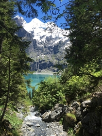 A glimpse of Oeschinensee Switzerland with Blemlisalp in the background